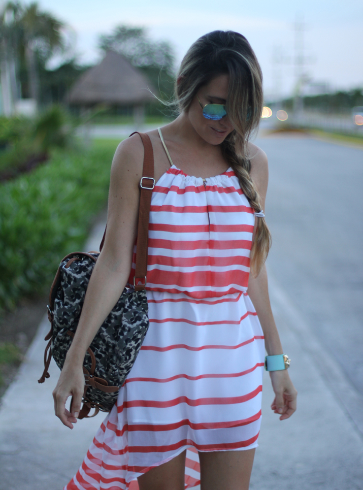 Wearing dress and backpack with mirrored sunglasses